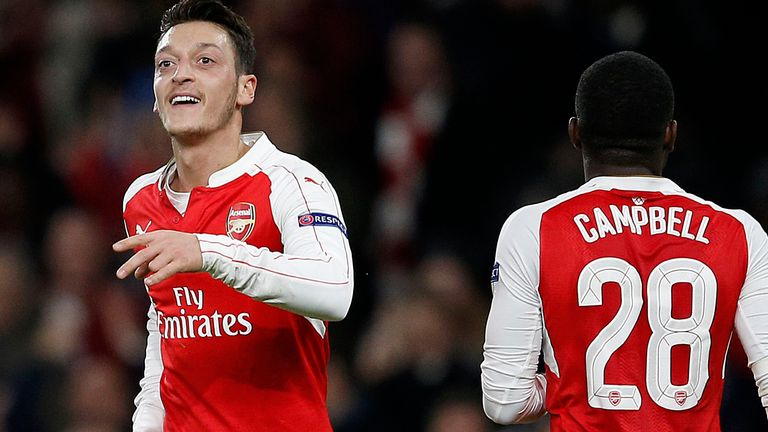 Arsenal midfielder Mesut Ozil (left) celebrates after opening the scoring