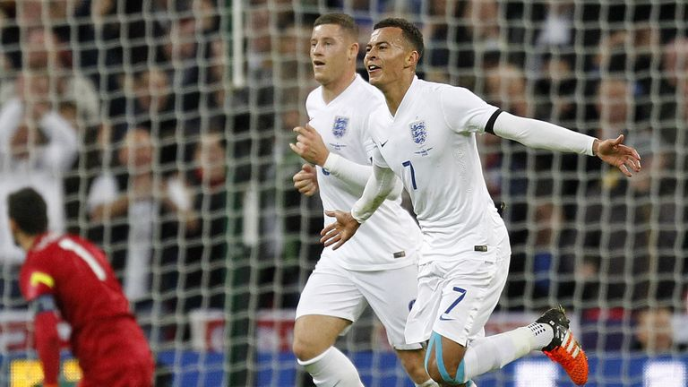 Dele Alli (right) celebrates scoring his first England goal against France at Wembley