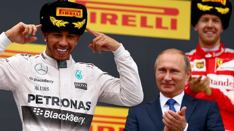 The main man: Sebastian Vettel and Vladimir Putin applaud Lewis Hamilton as he celebrates winning the Russian GP - Picture by  Dan Istitene, Getty Images