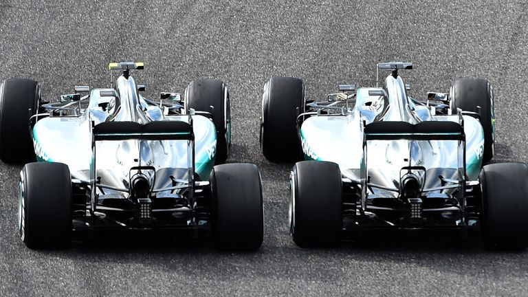Getting ahead: Lewis Hamilton out-muscles Nico Rosberg on the opening lap of the Japanese GP - Picture by Keith Sutton, Sutton Images