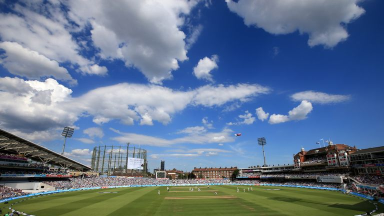 Fans watch the action during the Ashes Test between England and Australia at The Oval