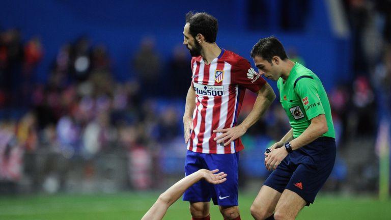 Tiago lies injured after suffering a broken leg against Espanyol
