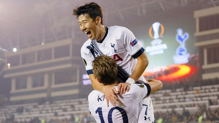 Harry Kane is congratulated by Heung-Min Son after opening the scoring in Baku