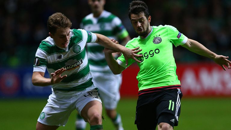 James Forrest vies with Amin Younes