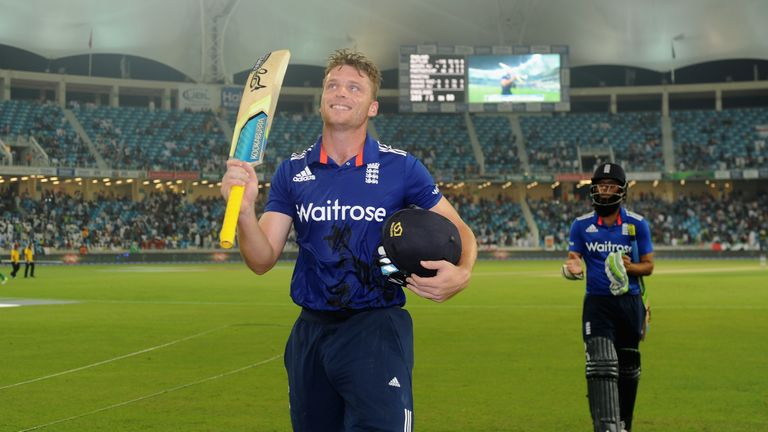 Jos Buttler raises his bat as he leaves the field after scoring the record fastest ODI hundred by an England batsman