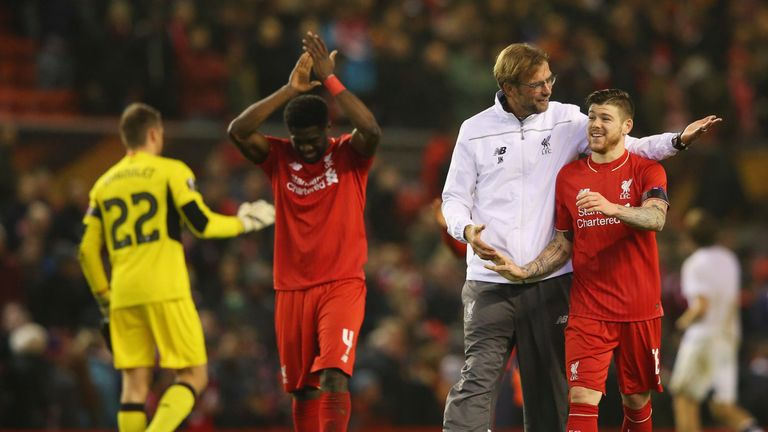 Jurgen Klopp embraces Alberto Moreno of Liverpool after victory over Bordeaux