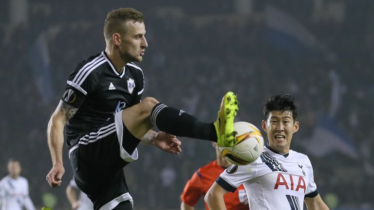 Maksim Medvedev of Qarabag is challenged by Son Heung-min