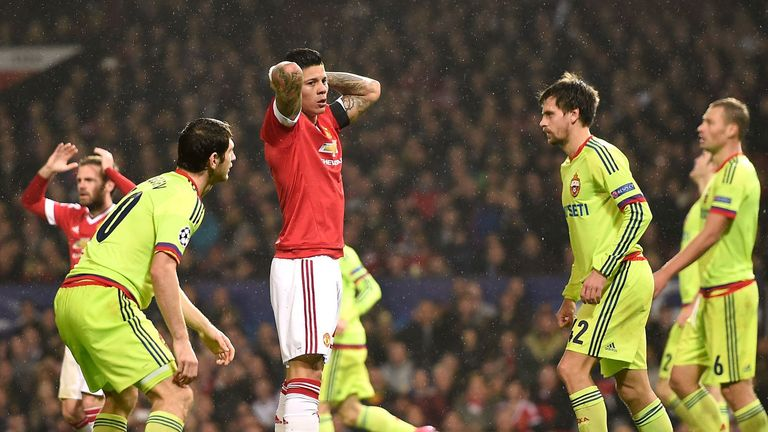 Manchester United's Marcos Rojo (centre) looks dejected after missing a chance