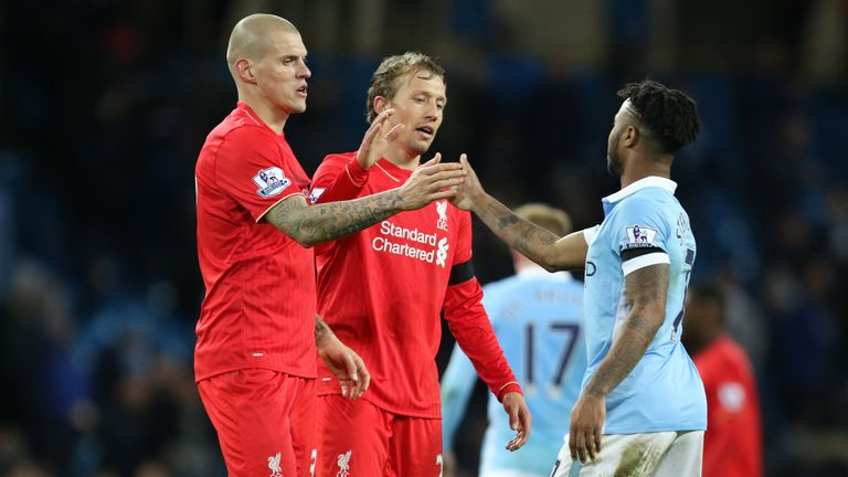 Manchester City's Raheem Sterling is consoled by Liverpool's Martin Skrtel and Liverpool's Lucas Leiva