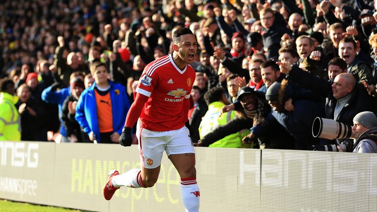 Memphis Depay celebrates his opening goal against Watford at Vicarage Road