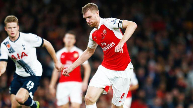 Arsenal defender Per Mertesacker on the ball against Tottenham