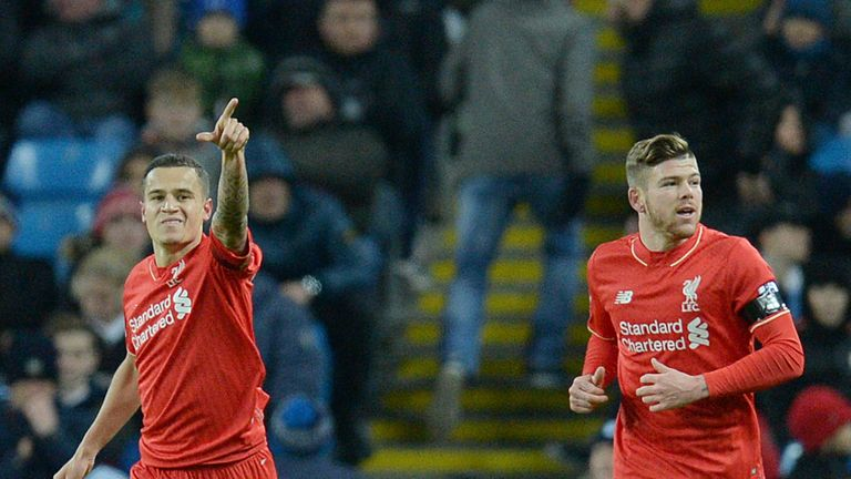 Philippe Coutinho celebrates after putting Liverpool two up