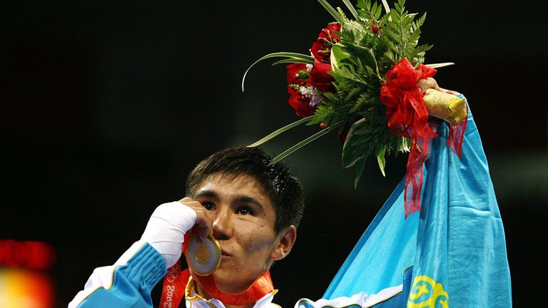 Bakhyt Sarsekbayev of Kazakhstan celebrates with the gold medal