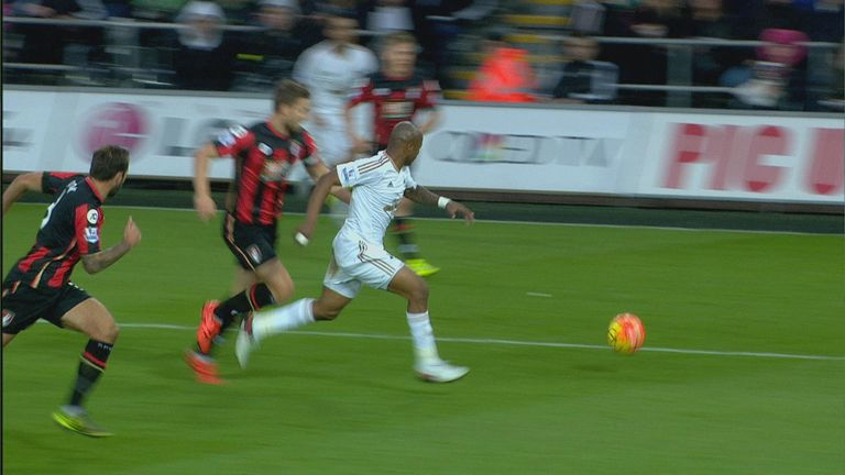 Simon Francis challenges Andre Ayew in the penalty area