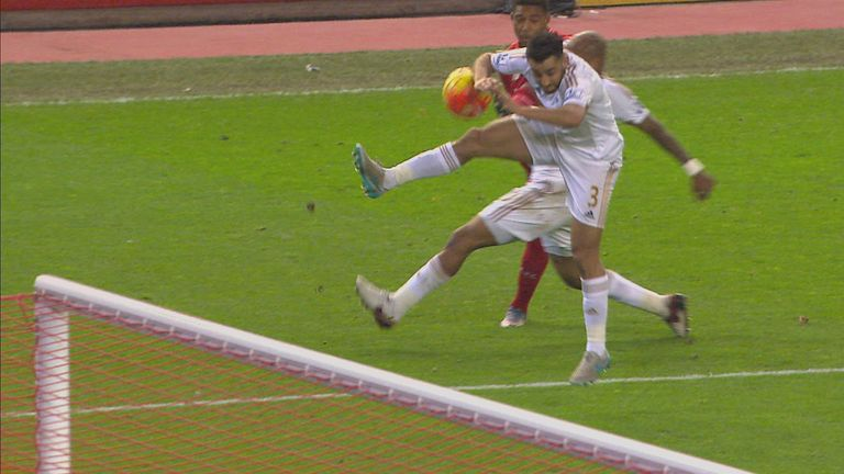 A penalty is awarded for a handball from Neil Taylor from a Jordon Ibe cross in Liverpool's win over Swansea