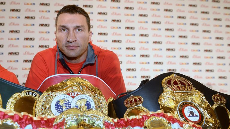 Wladimir Klitschko poses with his heavyweight title belts