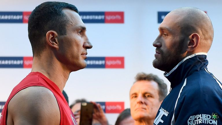 Wladimir Klitschko and Tyson Fury at the weigh-in