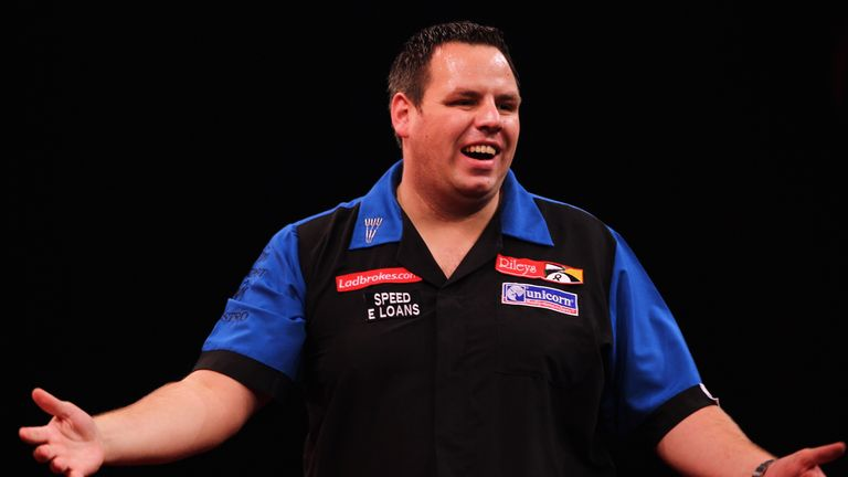 Adrian Lewis celebrates a set win against Gary Anderson after his perfect leg