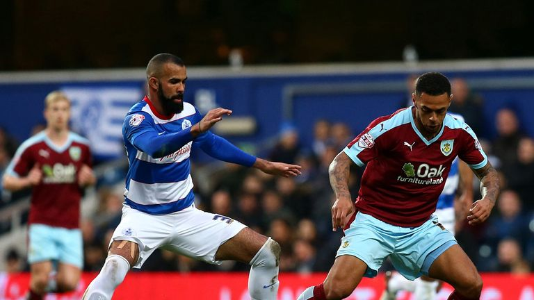 Andre Gray keeps the ball away from Sandro as the game ended goalless