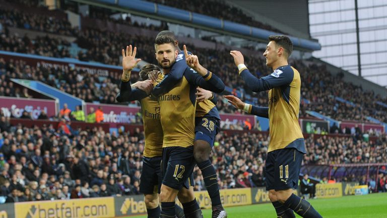 Olivier Giroud celebrates scoring the opening goal for Arsenal against Aston Villa