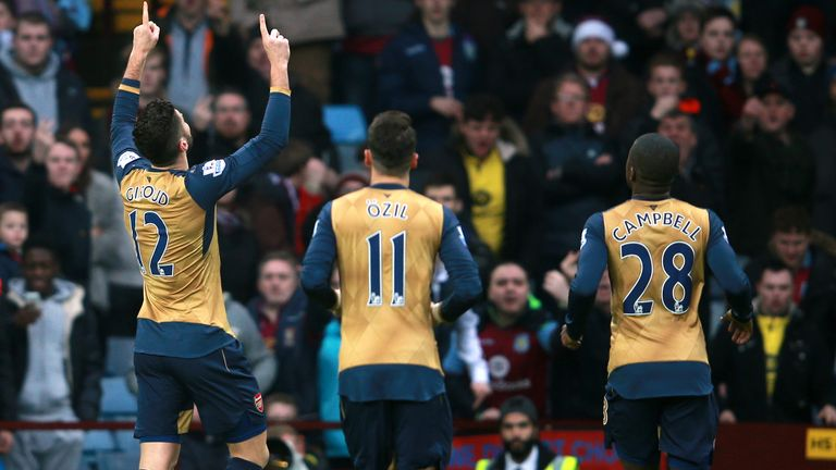 Giroud (left) points to sky after his penalty conversion