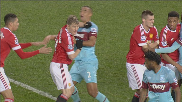 Schweinsteiger (2nd left) clashes with Winston Reid at Old Trafford