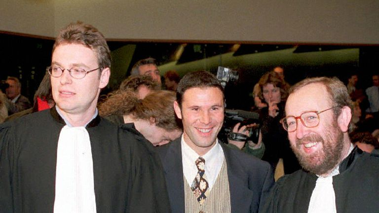 Jean-Marc Bosman (centre) flanked by two of his lawyers Luc Misson (right) and Jean-Louis Dupont (left) after the ruling was passed in 1995