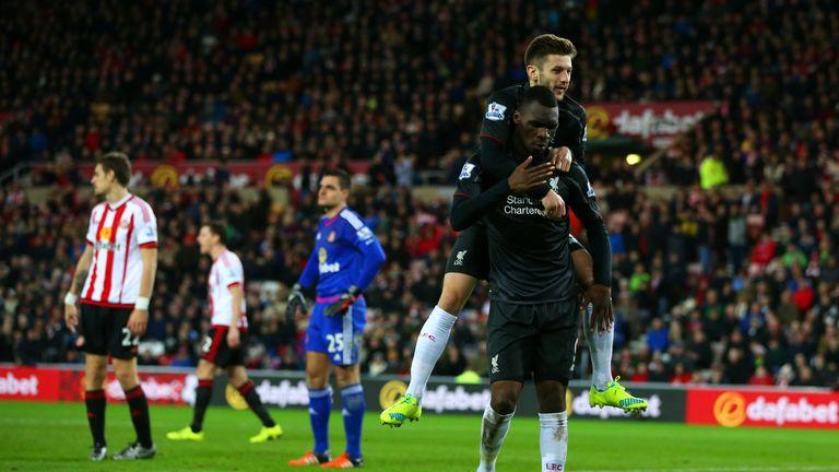 Christian Benteke celebrates his goal with Adam Lallana