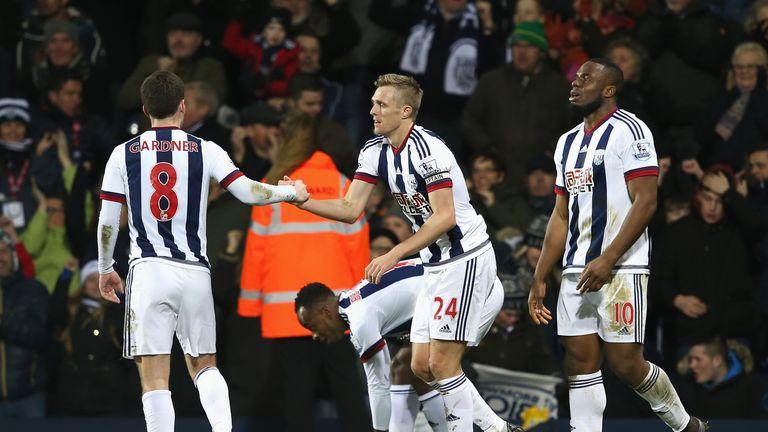 Fletcher (C) celebrates scoring his team's first goal against Newcastle United