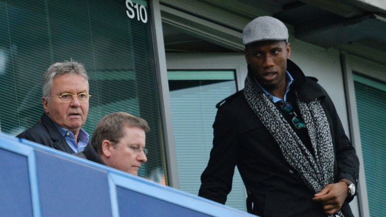 Chelsea's new interim manager Guus Hiddink (L) and former player Didier Drogba