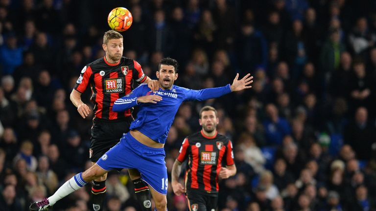 Diego Costa jumps for a header with Simon Francis - the Chelsea man started on the bench again