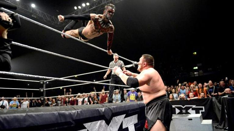 Finn Balor descends onto Samoa Joe