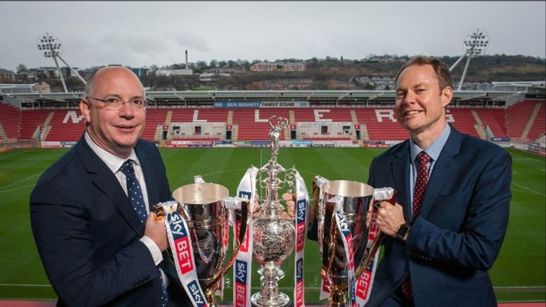 Football League chief executive Shaun Harvey and Sky Bet chief executive Richard Flint with the Football League's three main trophies
