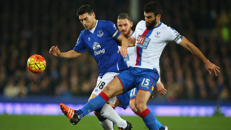 Gareth Barry challenges Mile Jedinak