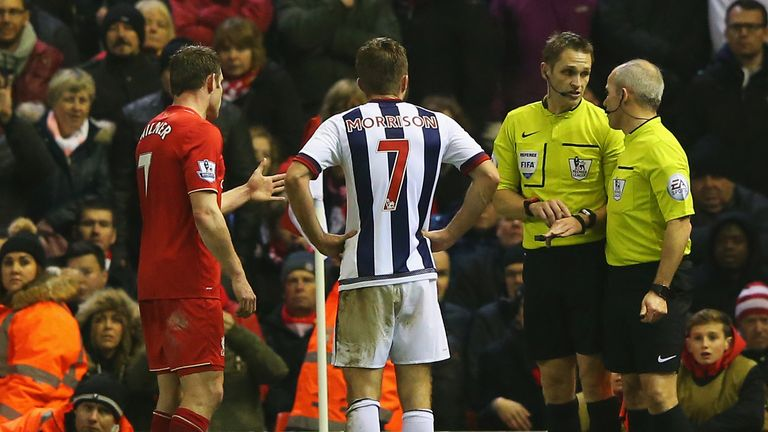 James Milner and James Morrison look on as the officials deliberate over the controversial offside decision