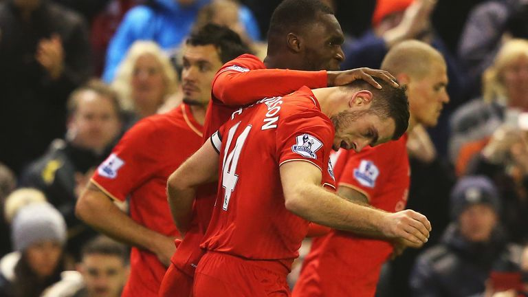 Jordan Henderson is congratulated by Christian Benteke after putting Liverpool in front
