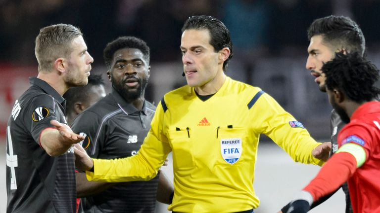 Jordan Henderson complains with the match referee during the 0-0 draw in Switzerland
