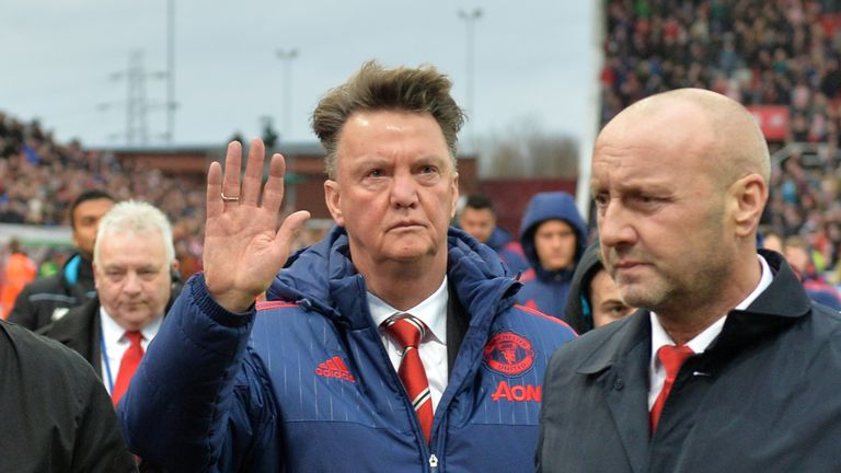 Manchester United manager Louis van Gaal holds his hand up as he leaves the pitch at the Britannia Stadium