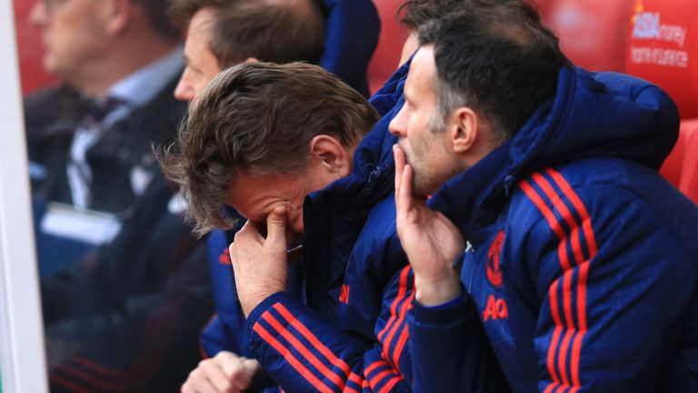 Manchester United manager Louis van Gaal sits dejected on the bench during the defeat by Stoke