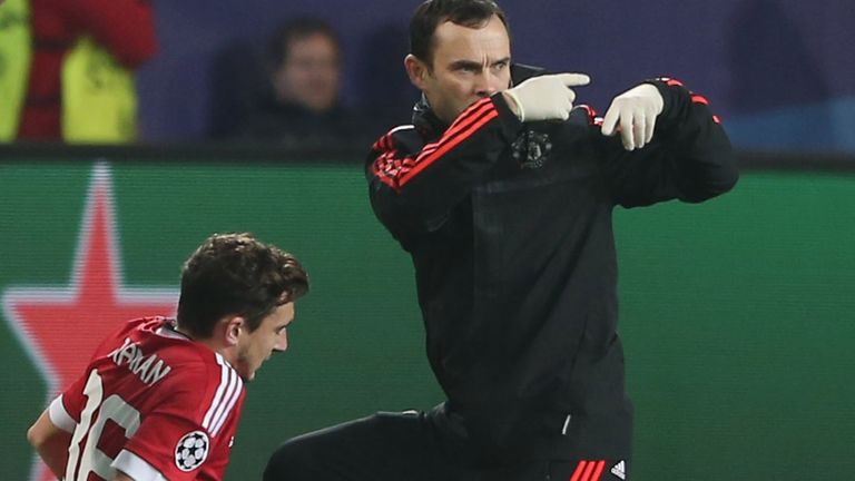 Matteo Darmian of Manchester United receives treatment before exiting the game