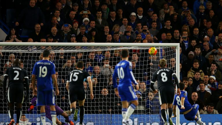 Oscar watches the ball fly over the bar as he slips taking a penalty