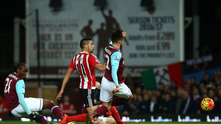 Carl Jenkinson turns the ball into his own net