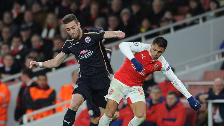 Ivo Pinto (left) tangles with Alexis Sanchez of Arsenal