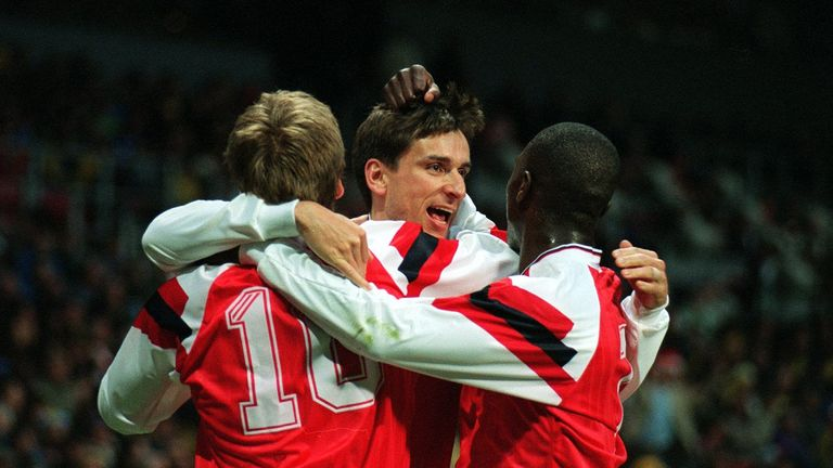 Alan Smith is congratulated by his team-mates following his goal against Parma