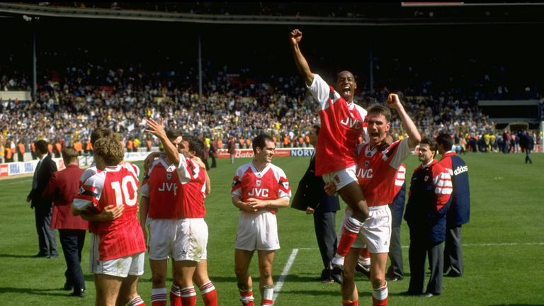 Ian Wright and Andy Linighan celebrate their victory over Tottenham in the FA Cup semi-final at Wembley