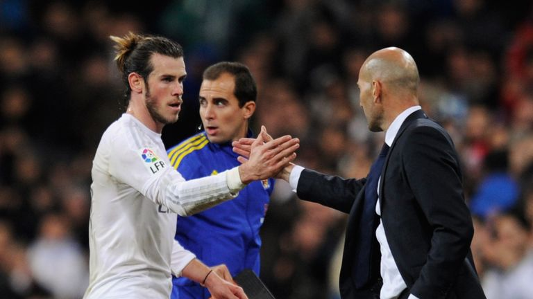 Bale is congratulated by new boss Zinedine Zidane after his hat-trick