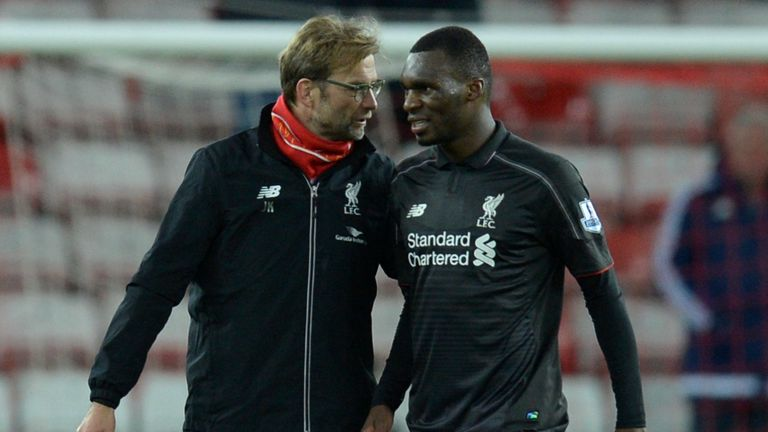 Christian Benteke (right) has started just two of the last six Premier League games for Liverpool