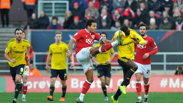 Bristol City's Korey Smith (left) and Middlesbrough's Albert Adomah in action