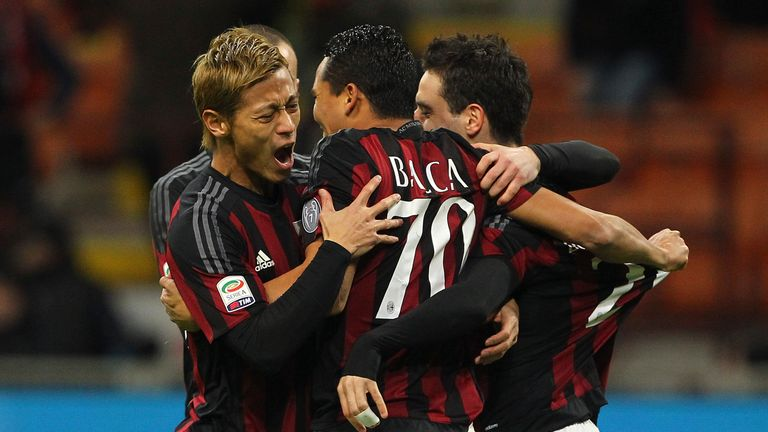 Carlos Bacca (centre) celebrates with his team-mates Keisuke Honda (left) and Giacomo Bonaventura (right) after scoring against Inter on Sunday