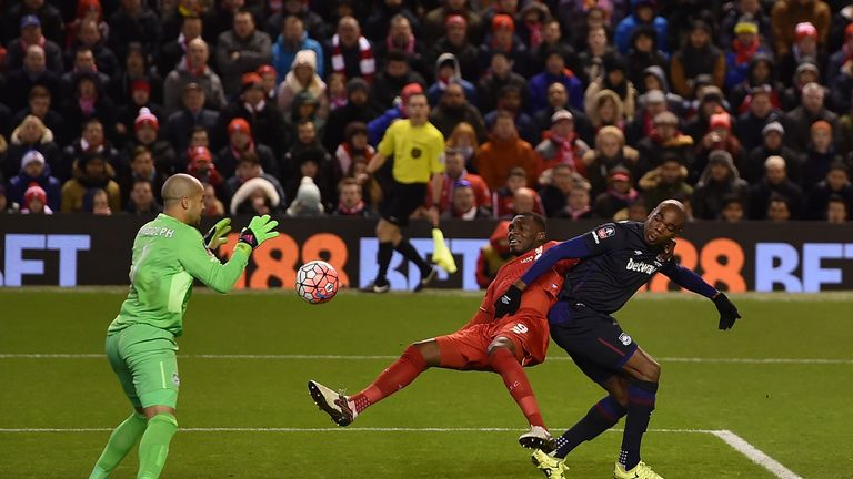 Christian Benteke of Liverpool is thwarted in his attempt at goal in the FA Cup fourth-round match against West Ham